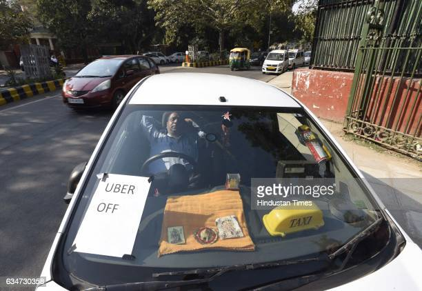 Ola and Uber taxi drivers on second day strike against withdrawal of driver incentives and other demands at Tolstoy Marg near Jantar Mantar on...