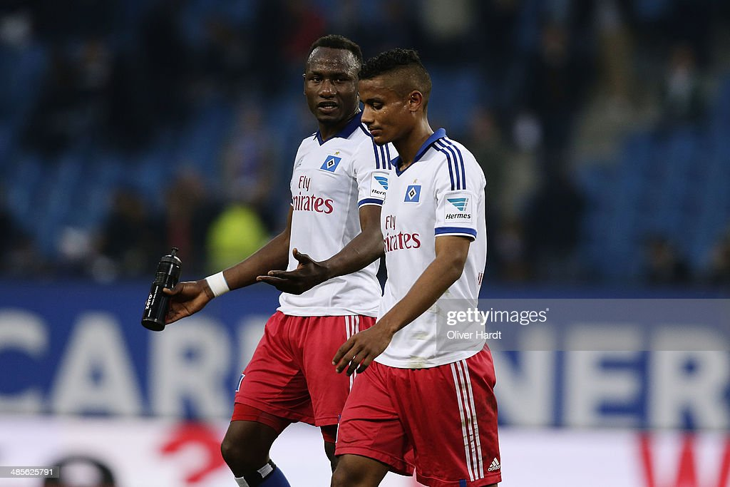 Ola John (R) and Michael Mancienne (R) of Hamburg appears frustrated after the Bundesliga match between Hamburger SV and VfL Wolfsburg at Imtech Arena on April 19, 2014 in Hamburg, Germany.