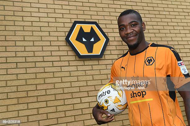 Ola John of Benfica signs a season long loan at Wolverhampton Wanderers at Molineux on August 22 2016 in Wolverhampton England