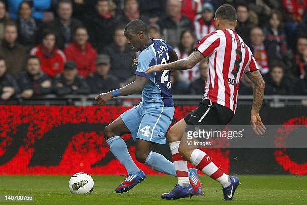 Ola John of FC Twente , Wilfred Bouma of PSV during the Dutch Eredivisie match between PSV Eindhoven and FC Twente at Phillips Stadium on March 4,...