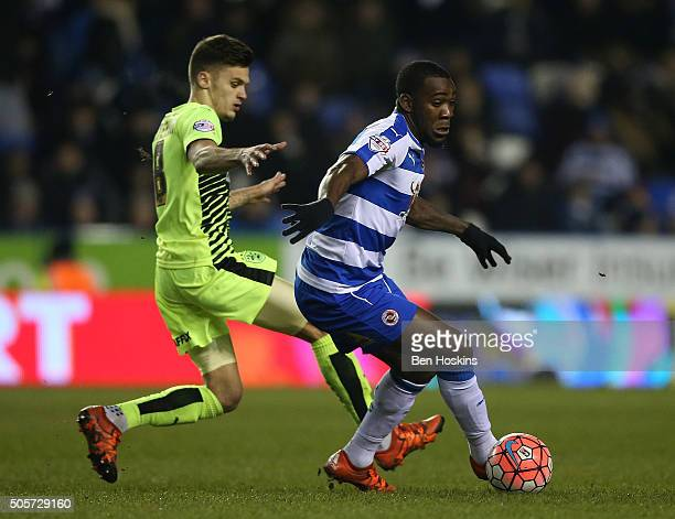 Ola John of Reading holds off pressure from Jamie Paterson of Huddersfield during The Emirates FA Cup Second Round match between Reading and...