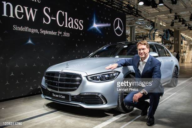 Ola Kaellenius CEO of Daimler AG poses next to the new SClass MercedesBenz passenger car at the new Factory 56 assembly line at the MercedesBenz...