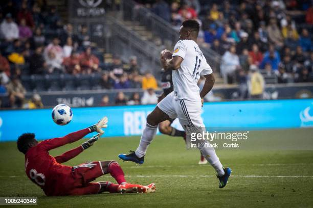 Ola Kamara of LA Galaxy gets his shot past goalkeeper Andre Blake of Philadelphia Union for a goal during the Major League Soccer match between LA...