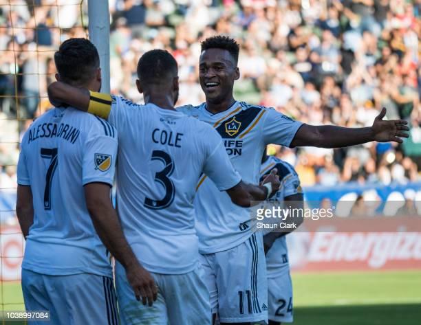 Ola Kamara of Los Angeles Galaxy celebrates his goal with Romain Alessandrini and Ashley Cole of Los Angeles Galaxy during the Los Angeles Galaxy's...