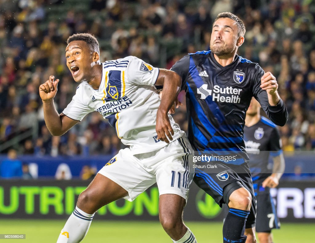 Ola Kamara #11 of Los Angeles Galaxy goes for goal as Jimmy Ockford #15 of San Jose Earthquakes defends during the Los Angeles Galaxy's MLS match against San Jose Earthquakes at the StubHub Center on May 25, 2018 in Carson, California. The Los Angeles Galaxy won the match 1-0