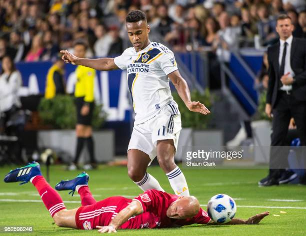 Ola Kamara of Los Angeles Galaxy is defended by Aurelien Collin of New York Red Bulls during the Los Angeles Galaxy's MLS match against New York Red...