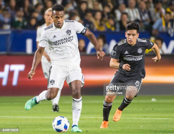 Ola Kamara of Los Angeles Galaxy passes the ball as he is closed down by Ezequiel Barco of Atlanta United during the Los Angeles Galaxy's MLS match...