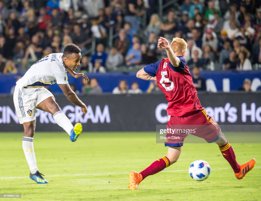 Ola Kamara #11 of Los Angeles Galaxy scores a goal as Justen Glad #15 of Real Salt Lake defends during the Los Angeles Galaxy's MLS match against FC Dallas at the StubHub Center on June 9, 2018 in Carson, California. Los Angeles Galaxy won the match 3-0