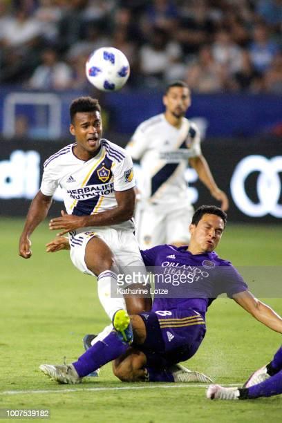 Ola Kamara of the Los Angeles Galaxy and Tony Rocha of Orlando City SC fight for control of the ball at StubHub Center on July 29 2018 in Carson...