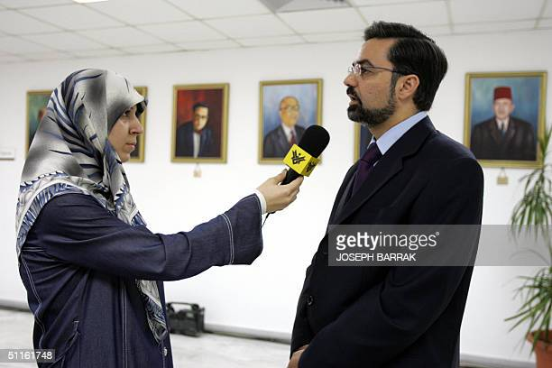 Ola Makki a reporter from AlManar television mouthpiece of the Lebanese Shiite Muslim Party of God or Hezbollah interviews Lebanese MP Bassem Yamut...
