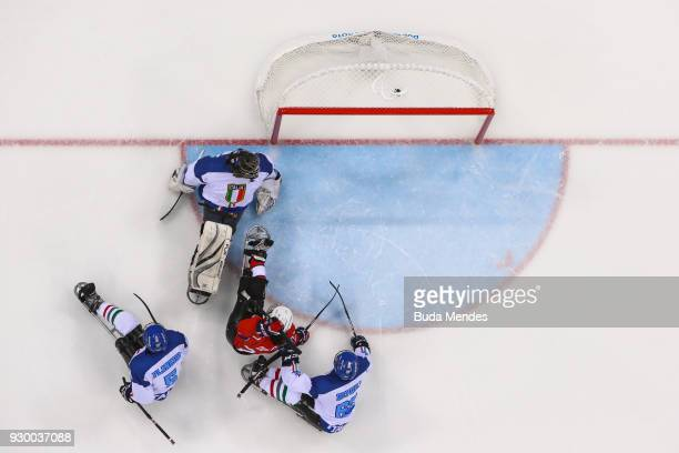 Ola Oiseth of Norway scores against goalkeeper Gabriele Araudo of Italy in the Ice Hockey Preliminary Round Group A game between Norway and Italy...
