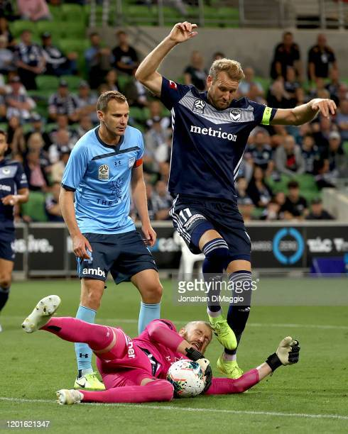 Ola Toivonen of Melbourne and Andrew Redmayne of Sydney collide during the round 16 A-League match between the Melbourne Victory and Sydney FC at...
