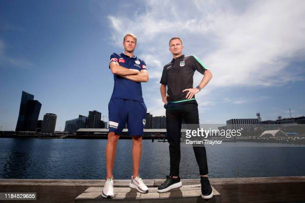 Ola Toivonen of Melbourne Victory and Besart Berisha of Western United pose for a photo during the Melbourne Victory v Western Sydney Wanderers Media...