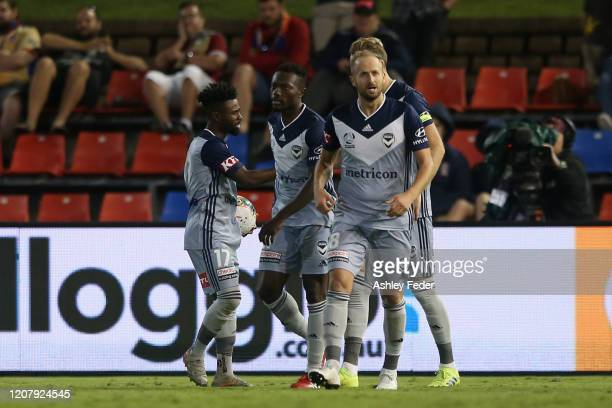 Ola Toivonen of Melbourne Victory celebrates his goal with team mates during the round 20 A-League match between the Newcastle Jets and the Melbourne...