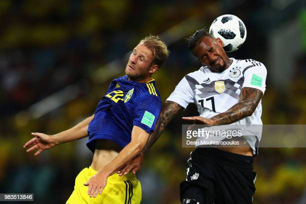 Ola Toivonen of Ola Toivonen battles for the header ball with Jerome Boateng of Germany during the 2018 FIFA World Cup Russia group F match between...