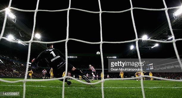 Ola Toivonen of PSV takes and misses a penalty as goal keeper Dennis Gentenaar of Venlo dives during the Eredivisie match between PSV Eindhoven v VVV...