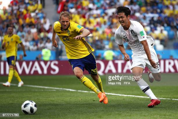 Ola Toivonen of Sweden and Kim Young-Gwon of Korea Republic chase after the ball during the 2018 FIFA World Cup Russia group F match between Sweden...