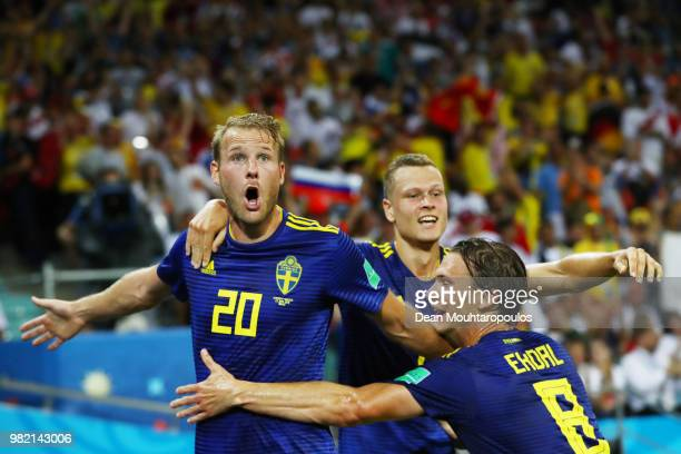 Ola Toivonen of Sweden celebrates with Albin Ekdal after scoring the opening goal during the 2018 FIFA World Cup Russia group F match between Germany...