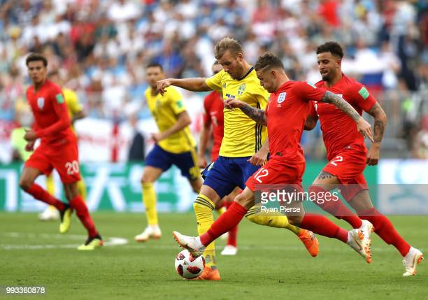 Ola Toivonen of Sweden challenge for the ball with Kieran Trippier of England during the 2018 FIFA World Cup Russia Quarter Final match between...