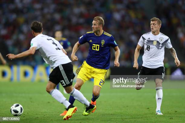 Ola Toivonen of Sweden challenge for the ball with Toni Kroos and Jonas Hector during the 2018 FIFA World Cup Russia group F match between Germany...