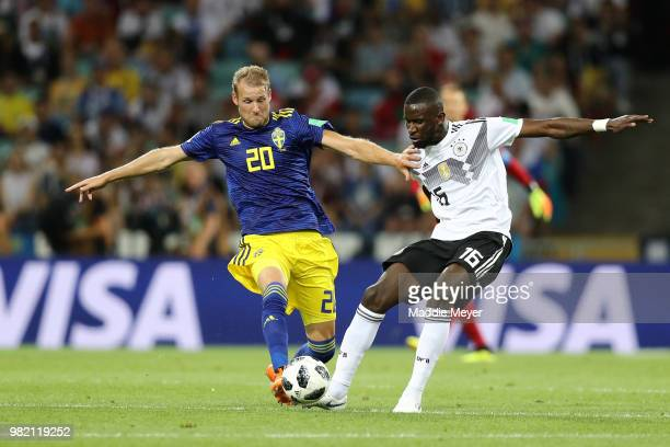 Ola Toivonen of Sweden is tackled by Antonio Ruediger of Germany during the 2018 FIFA World Cup Russia group F match between Germany and Sweden at...