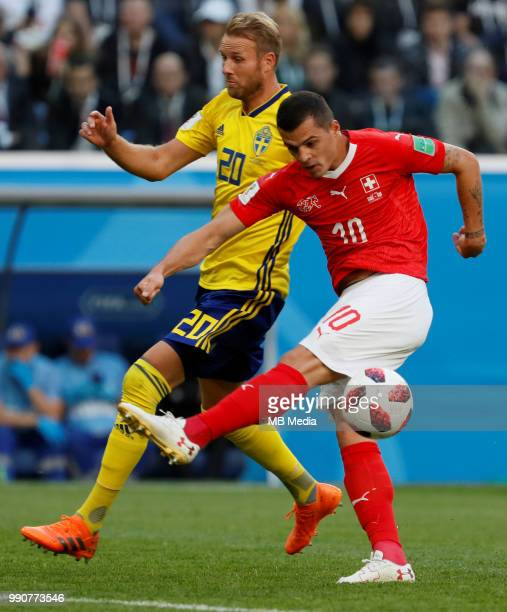 Ola Toivonen of Sweden national team and Granit Xhaka of Switzerland national team in action during the 2018 FIFA World Cup Russia Round of 16 match...