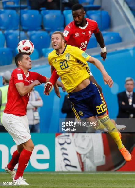 Ola Toivonen of Sweden national team vies for a header with Granit Xhaka and Johan Djourou of Switzerland national team during the 2018 FIFA World...