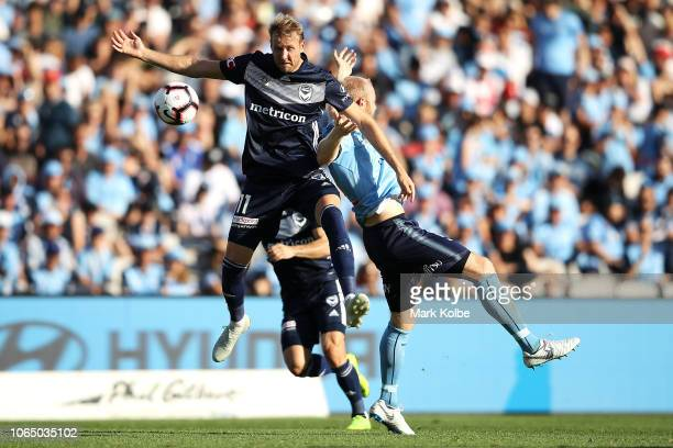 Ola Toivonen of the Victory and Jop Van Der Linden of Sydney FC compete for the ball during the round five ALeague match between Sydney FC and...