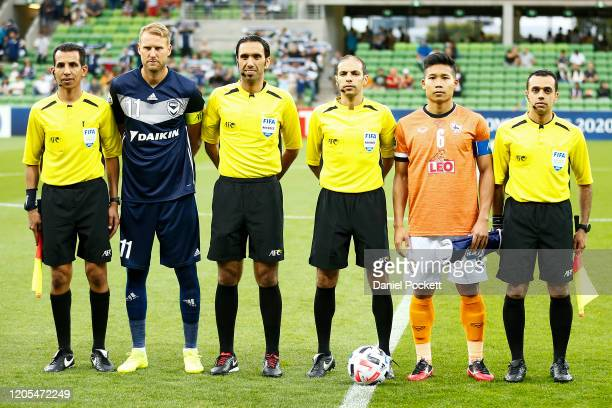 Ola Toivonen of the Victory and Phitiwat Sookjitthammakul of Chiangrai United pose with referees prior to the AFC Champions League Group E match...