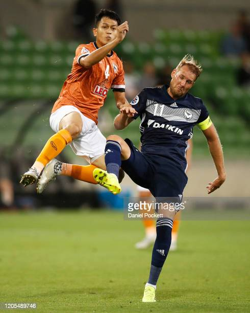 Ola Toivonen of the Victory and Piyaphon Phanitchakun of Chiangrai United contest the ball during the AFC Champions League Group E match between...