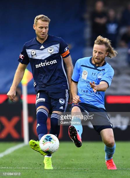 Ola Toivonen of the Victory and Rhyan Grant of Sydney FC compete for the ball during the round 22 A-League match between the Melbourne Victory and...