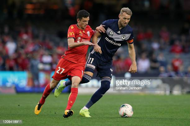 Ola Toivonen of the Victory is challenged for the ball by Louis D'Arrigo of Adelaide United during the round 21 A-League match between the Melbourne...