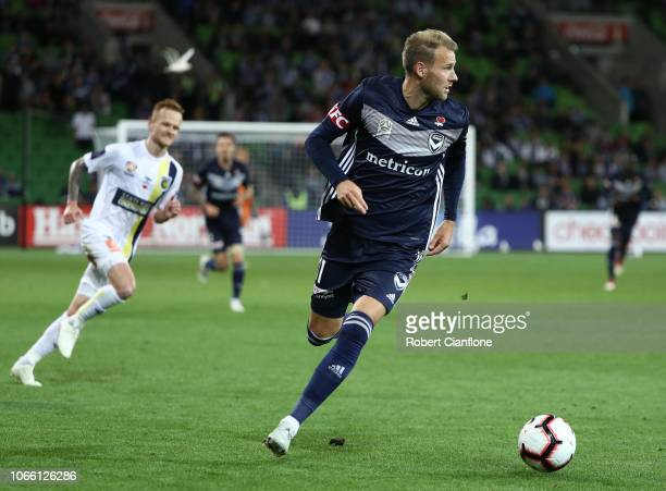 Ola Toivonen of the Victory runs with the ball during the round four ALeague match between the Melbourne Victory and the Central Coast Mariners at...