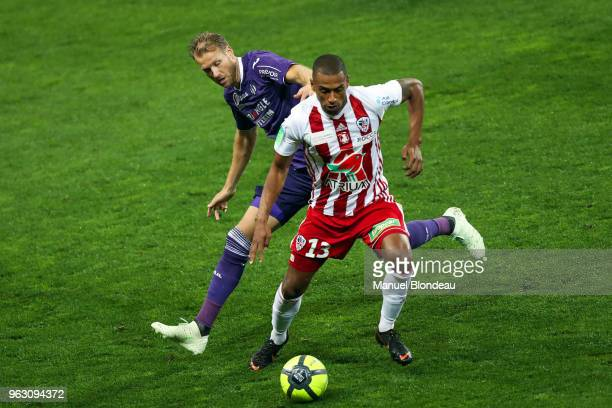 Ola Toivonen of Toulouse and Yann Boe Kane of Ajaccio during the Ligue 1 playoff match between Toulouse and AC Ajaccio on May 27 2018 in Toulouse...