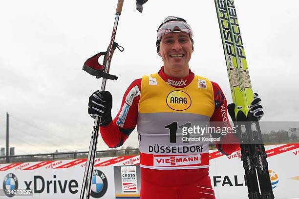 Ola Vigen Hattestad of Norway smiles after winning the men's 17 km sprint of the FIS Cross Country World Cup at the Dusseldorf city circuit on...