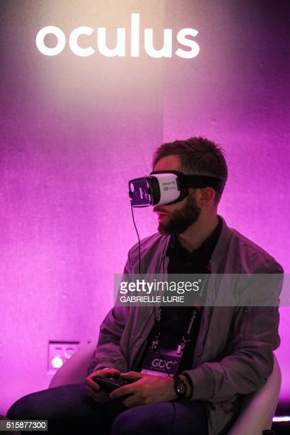 Olaf Carlson looks up with experiencing Minecraft for Gear VR while wearing Oculus goggles during a press demonstration at The Village event space in...