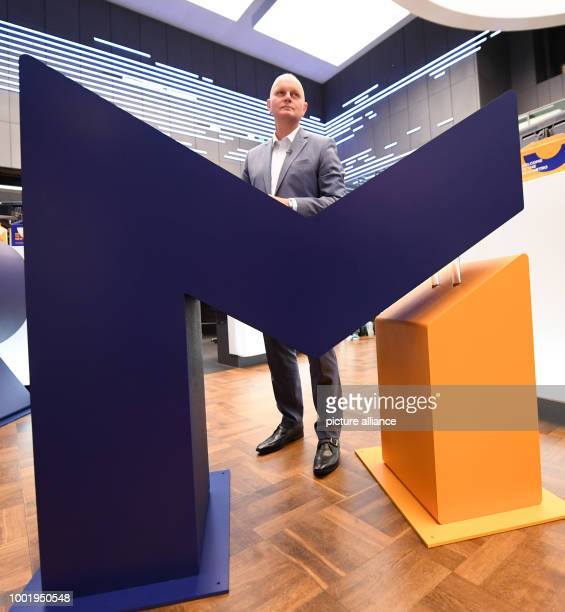 Olaf Koch CEO of der Metro Wholesale Food Specialist AG pictured beside an 'M' during the flotation of the new Metro on the trading floor at the...