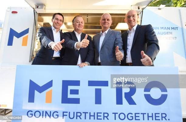 Olaf Koch CEO of der Metro Wholesale Food Specialist AG pictured with his board colleagues Christian Baier Pieter Boone and Heiko Hutmacher during...
