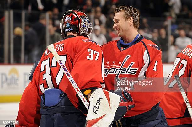 Olaf Kolzig of the Washington Capitals is congratulated by Brent Johnson after the game against the Minnesota Wild at the Verizon Center on February...