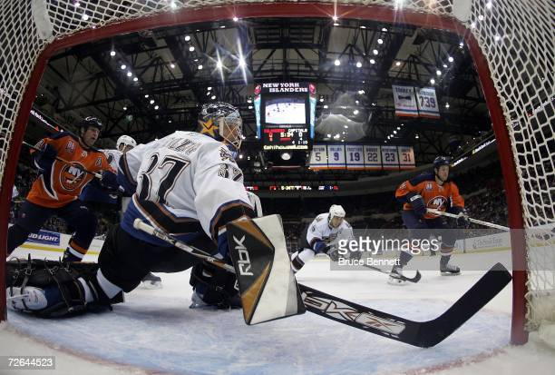 Olaf Kolzig of the Washington Capitals sprawls to make the save against the New York Islanders on November 25, 2006 at the Nassau Coliseum in...