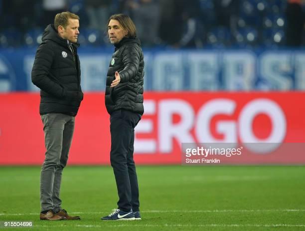 Olaf Rebbe sports diector and Martin Schmidt head coach of Wolfsburg discuss after the DFB Pokal quarter final match between FC Schalke 04 and VfL...