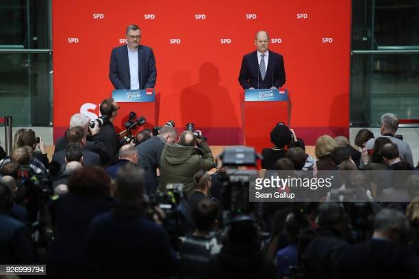 Olaf Scholz Acting Chairman of the German Social Democrats and SPD Treasurer Dietmar Nietan speak to journalists following the SPD member vote over...