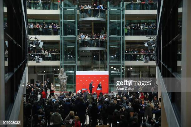 Olaf Scholz , Acting Chairman of the German Social Democrats , and SPD Treasurer Dietmar Nietan depart after speaking to journalists following the...