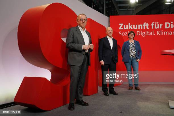 Olaf Scholz , chancellor candidate of the German Social Democrats , and SPD party co-leaders Norbert Walter-Borjans and Saskia Esken pose for a photo...