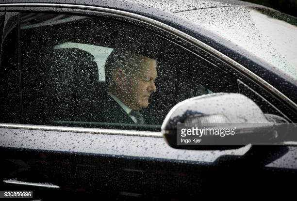 Olaf Scholz leaves by car to attend a press conference for the coalition agreement on March 12 2018 in Berlin Germany