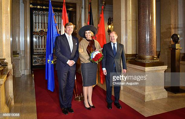 Olaf Scholz mayor of Hamburg welcomes Queen Maxima and King WillemAlexander of The Netherlands at the town hall on March 19 2015 in Hamburg Germany