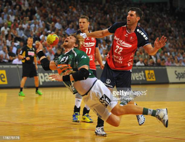 Olafur Gustafsson of Flensburg challenges for the ball with Manuel Spaeth of Goeppingen during th DKB Bundesliga game between SG Flensburg Handewitt...