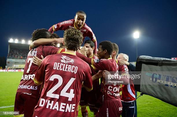 Olafur Skulason of Zulte-Waregem celebrates withteam-mates during the Jupiler League match between Zulte Waregem and Standard de Liege on October 06...