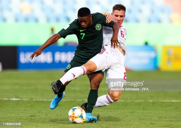 Olakunle Olusegun of Nigeria and Mihaly Kata of Hungary fight for the ball during the match for FIFA U17 World Cup Brazil 2019 at Estadio Olimpico on...