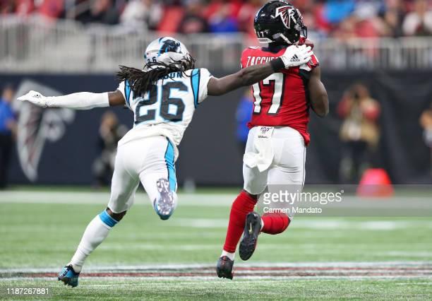 Olamide Zaccheaus of the Atlanta Falcons makes a reception for a touchdown in front of defender Donte Jackson of the Carolina Panthers during the...